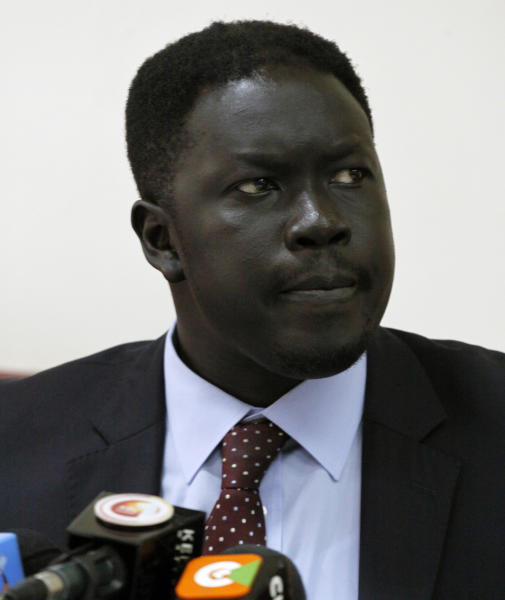 Choul Laam, the chief of staff for the secretary general for the ruling Sudanese Peoples Liberation Movement speaks during a press conference in Nairobi, Kenya, Thursday, Dec. 19, 2013. Laam said on Thursday that an attempt in the presidential guard by the majority Dinka tribe members of President Salva Kiir to disarm the minority members of the Nuer community of former vice president Riek Machar sparked off the fighting Sunday. Laam says the fighting then spilled outside the barracks. Tensions had been mounting since Kiir fired Machar as his deputy in July. (AP Photo/Khalil Senosi)