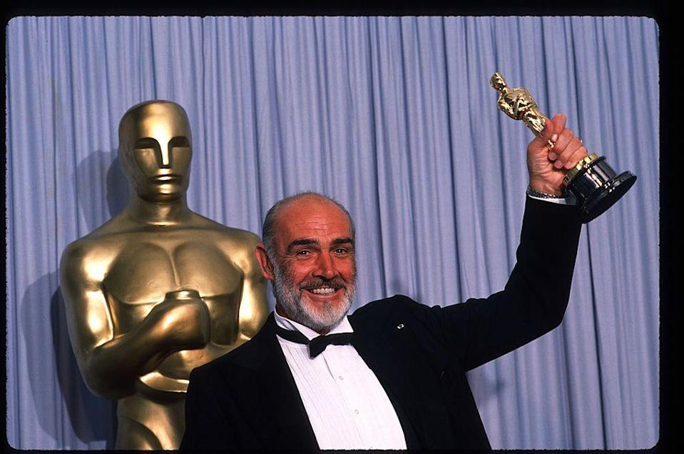 <p>Connery holds up his Best Actor in a Supporting Role Oscar for The Untouchables at the Academy Awards April 11, 1988</p>