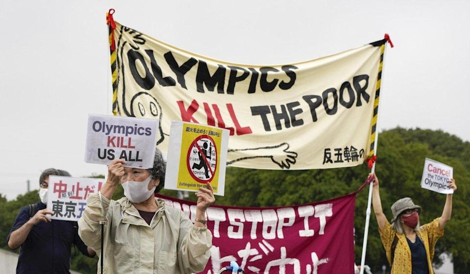 Demonstrators protest against the Tokyo 2020 Olympics outside the venue for the unveiling ceremony of the Olympic Torch at the Komazawa Olympic Park. Photo: EPA