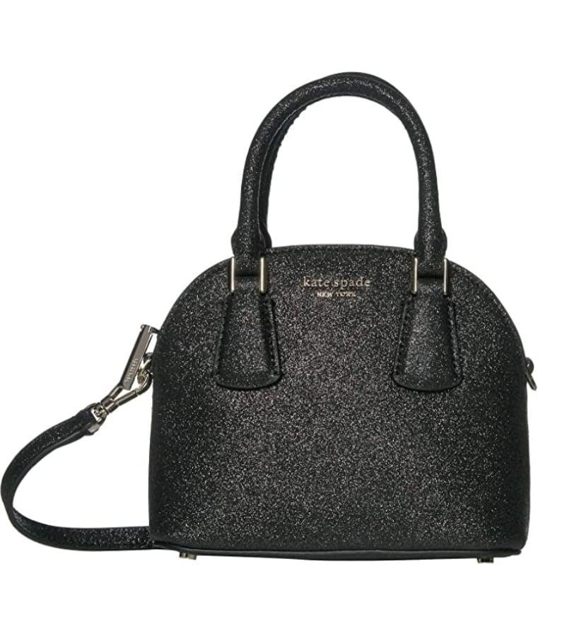 <p>This <span>Kate Spade New York Mini Sylvia Glitter Dome Satchel </span> ($188) will go with everything.</p>
