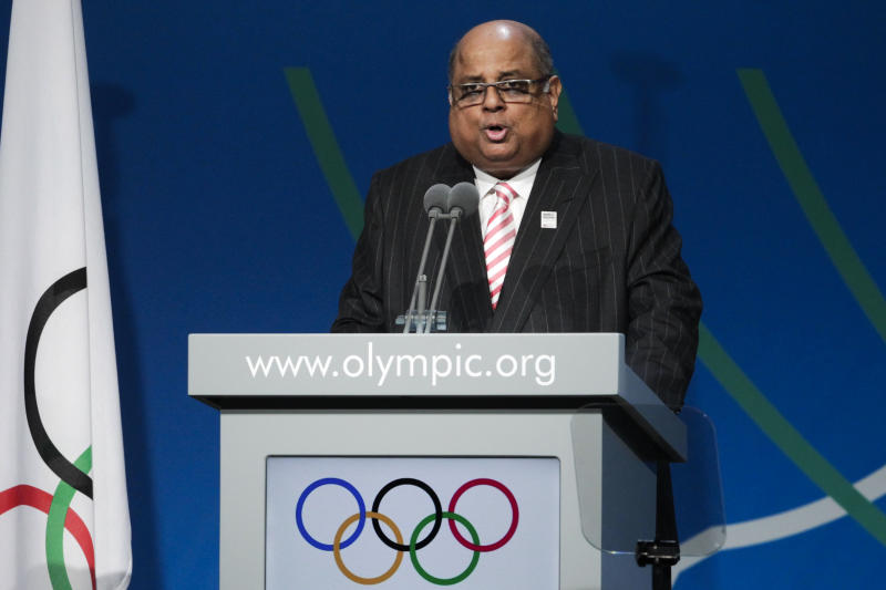 Narayana Ramachandran of India, president of the World Squash Federation (WSF), speaks during the sports' presentation during the 125th IOC session in Buenos Aires, Argentina, Sunday, Sept. 8, 2013. During the meeting members will elect a new sport choosing between wrestling, squash and baseball, that is presenting a joint bid with softball.(AP Photo/Victor R. Caivano)