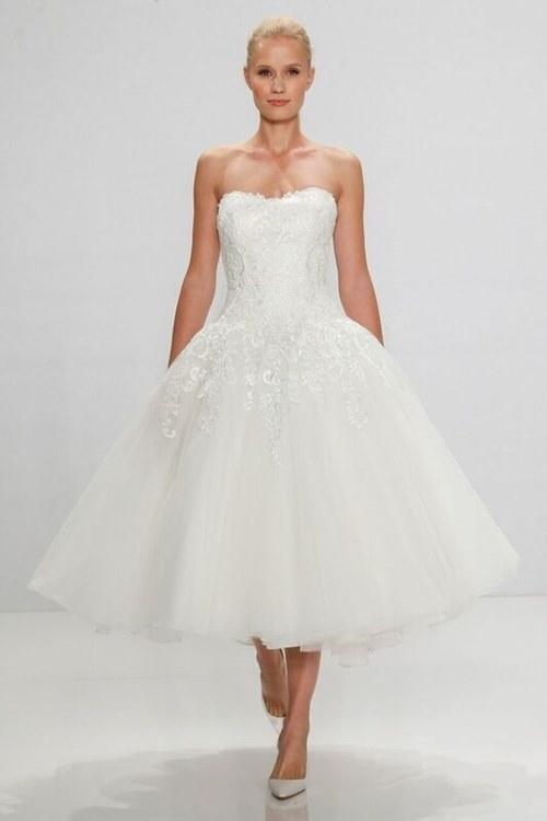 """<p>Tulle has always been a bridal-dress favorite, but never has it looked more ballet beautiful than when used in a tea-length wedding dress for a tutu-esque effect. This mini showstopper by <a rel=""""nofollow"""" href=""""http://www.kleinfeldbridal.com/index.cfm?item_id=19317&mbid=synd_yahoostyle&pid=52"""">Dennis Basso for Kleinfeld</a> features a dropped waist, tulle, and lace—perfectly <a rel=""""nofollow"""" href=""""http://www.brides.com/story/wedding-inspiration-theme-ideas-swan-lake?mbid=synd_yahoostyle""""><em>Swan Lake</em></a>.</p>"""