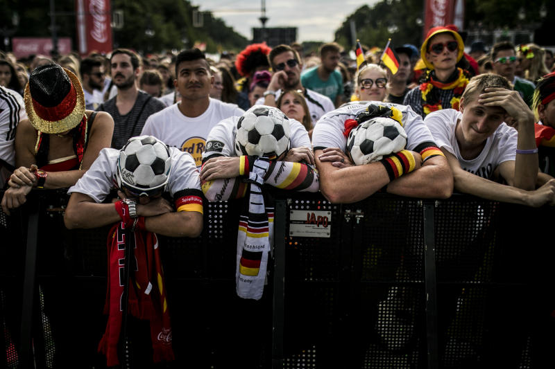 BERLIN, GERMANY - JUNE 27: Fans react during the public viewing in front of the Brandenburg Gate of the game Germany versus South Korea at the FIFA Soccer World Championship on June 27, 2018 in Berlin, Germany. (Photo by Florian Gaertner/Photothek via Getty Images)