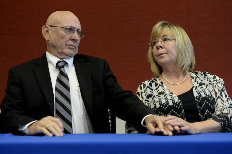 DENVER, CO. - SEPTEMBER 16: Lonnie and Sandy Phillips during a press conference at Arnold and Porter LLP in Denver, CO, September 16, 2014. The Brady Center to Prevent Gun Violence announced a lawsuit against Lucky Gunner and other online retailers of lethal and dangerous products on behalf of Lonnie and Sandy Phillips. Their daughter Jessica Ghawi was killed in the Aurora theater shooting July 20, 1012. (Photo By Craig F. Walker / The Denver Post)