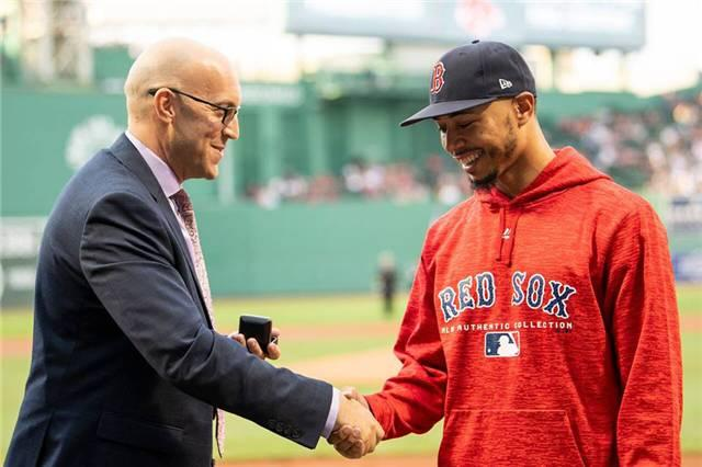 PBA commissioner Tom Clark presents Mookie Betts with a PBA 300 ring for rolling a perfect game in a PBA event. (Courtesy of the PBA)