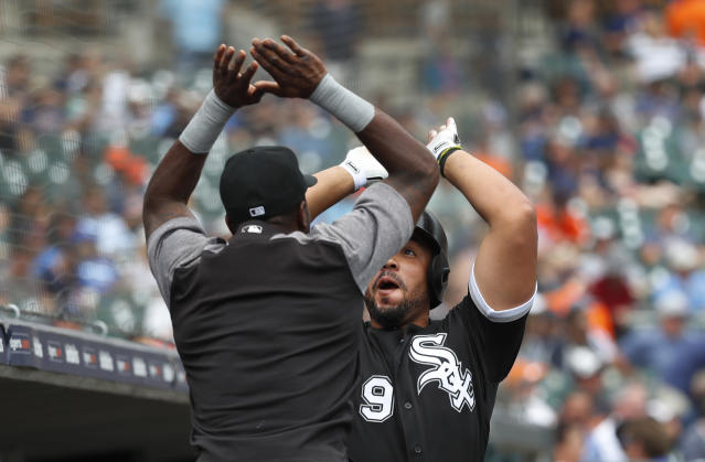 Chicago White Sox's Jose Abreu (79) celebrates his two-run home run with Tim Anderson in the fifth inning of a baseball game against the Detroit Tigers in Detroit, Wednesday, Aug. 15, 2018. (AP Photo/Paul Sancya)