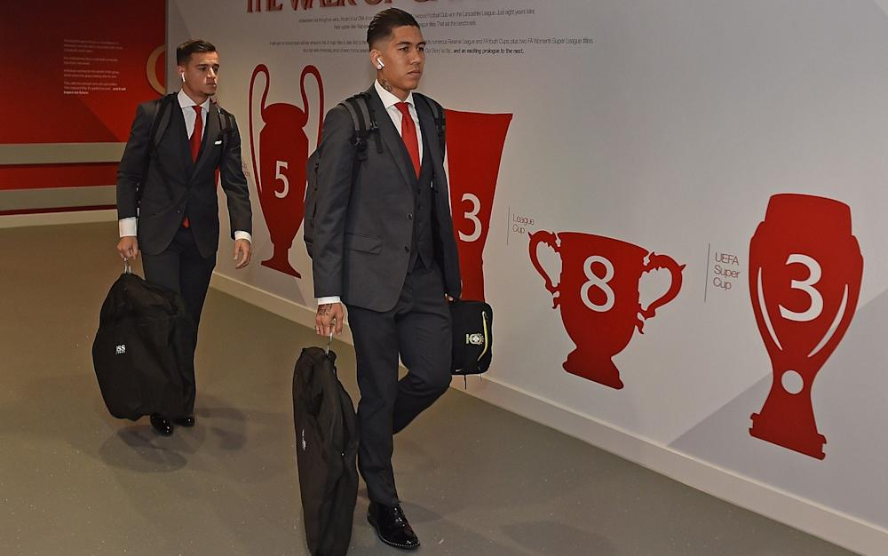Brazilians Roberto Firmino and Philippe Coutinho head to the changing rooms - Credit: Getty images