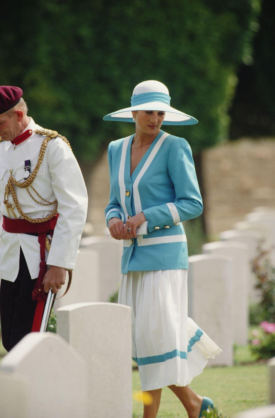 <p>In a blue and white suit designed by Catherine Walker and a matching hat by Philip Somerville while visiting the Heliopolis War Cemetery in Cairo. </p>