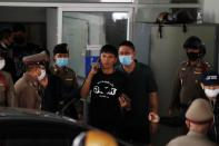 Panupong Jadnok, a pro-democracy student, one of the leaders of Thailand's recent anti-government protests, is seen at the police station after being arrested, in Bangkok