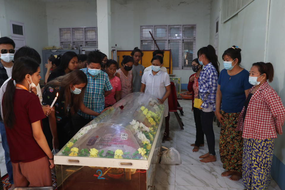 People view the body of Kyal Sin, also known by her Chinese name Deng Jia Xi, a 20-year-old university student who was shot in the head while she was attending an anti-coup protest rally in Mandalay, Myanmar, Wednesday, March 3, 2021. Myanmar security forces shot and killed multiple people Wednesday, according to accounts on social media and local news reports, as authorities extended their lethal crackdown on protests against last month's coup. (AP Photo)