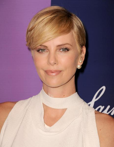 Actress Charlize Theron arrives at Variety's 5th Annual Power of Women event at the Beverly Wilshire Hotel on Friday, Oct. 4, 2013, in Beverly Hills, Calif. (Photo by Jordan Strauss/Invision/AP)