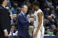 Xavier head coach Travis Steele, center left, speaks to KyKy Tandy (24) during the second half of an NCAA college basketball game against Lipscomb, Saturday, Nov. 30, 2019, in Cincinnati. (AP Photo/John Minchillo)