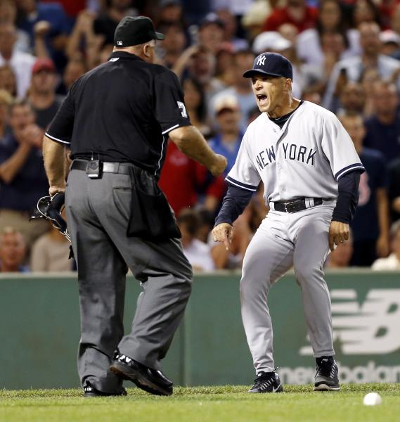 """FILE - In this Aug. 18, 2013 file photo, New York Yankees manger Joe Girardi, right, argues with home plate umpire Brian O'Nora after Alex Rodriguez was hit by a pitch in the second inning of a baseball game in Boston. Girardi saw the replays of Atlanta outfielder Jason Heyward being hit in the face by a pitch that broke his jaw. That's why the Yankees manager was furious at Boston's Ryan Dempster for throwing at Alex Rodriguez a few days earlier. """"It can change a player's life,"""" he says. (AP Photo/Michael Dwyer, File)"""