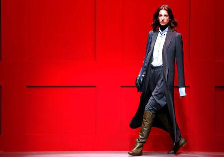 A model presents a creation from the Salvatore Ferragamo Autumn/Winter 2018 women collection during Milan Fashion Week in Milan, Italy February 24, 2018.  REUTERS/Alessandro Garofalo