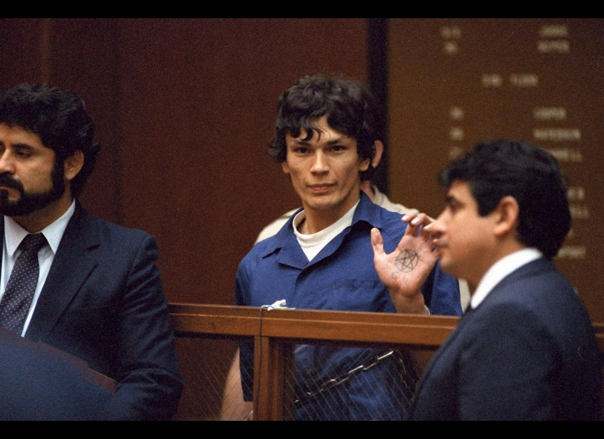 In this file photo taken Oct. 24, 1985, &quot;Night Stalker&quot; Richard Ramirez displays a pentagram symbol on his hand inside a Los Angeles courtroom. The California Supreme Court Monday< Aug. 7, 2006, upheld the convictions and death sentence for serial killer Richard Ramirez, the so-called &quot;Night Stalker&quot; whose killing spree terrorized the Los Angeles area in the mid 1980s. Ramirez, now 46, was sentenced to death in 1989 for 13 Los Angeles-area murders committed in 1984 and 1985. Satanic symbols were left at some murder scenes and some victims were forced to &quot;swear to Satan&quot; by the killer, who broke into homes through unlocked windows and doors. (AP Photo/Lennox McLendon)