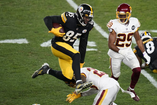 Pittsburgh Steelers tight end Eric Ebron (85) leaps over Washington Football Team cornerback Ronald Darby (23) after taking a pass from quarterback Ben Roethlisberger during the first half of an NFL football game, Monday, Dec. 7, 2020, in Pittsburgh. (AP Photo/Keith Srakocic)