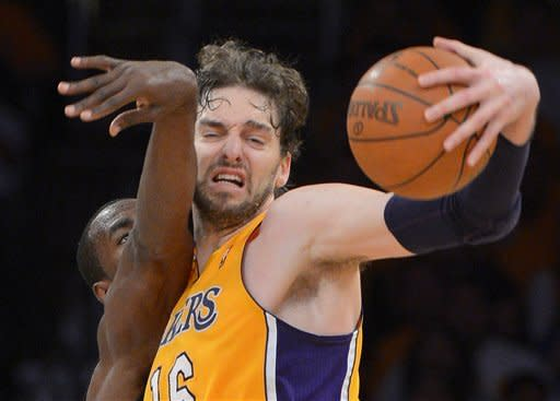 Oklahoma City Thunder forward Serge Ibaka, left, of Congo reaches for a rebound along with Los Angeles Lakers forward Pau Gasol of Spain during the second half in Game 3 of an NBA basketball playoffs Western Conference semifinal, Friday, May 18, 2012, in Los Angeles. The Lakers won 99-96. (AP Photo/Mark J. Terrill)