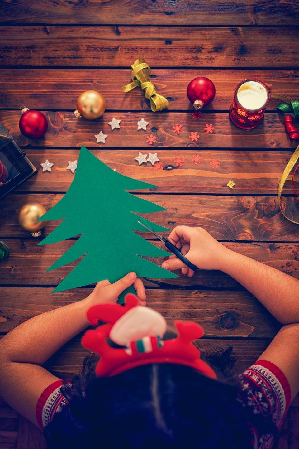 """<p>Feeling crafty? You can never have too many <a href=""""https://www.countryliving.com/life/kids-pets/g5030/christmas-crafts-for-kids/"""" rel=""""nofollow noopener"""" target=""""_blank"""" data-ylk=""""slk:Christmas crafts"""" class=""""link rapid-noclick-resp"""">Christmas crafts</a>. Get started on DIYs for next year by giving your kids paper, glitter, and glue!</p><p><a class=""""link rapid-noclick-resp"""" href=""""https://www.amazon.com/Crayola-Construction-Classic-Projects-Classrooms/dp/B003W0PBR2/ref=sr_1_2?dchild=1&keywords=craft+paper&qid=1632338624&sr=8-2&tag=syn-yahoo-20&ascsubtag=%5Bartid%7C10050.g.25411840%5Bsrc%7Cyahoo-us"""" rel=""""nofollow noopener"""" target=""""_blank"""" data-ylk=""""slk:SHOP CRAFT PAPER"""">SHOP CRAFT PAPER</a></p>"""