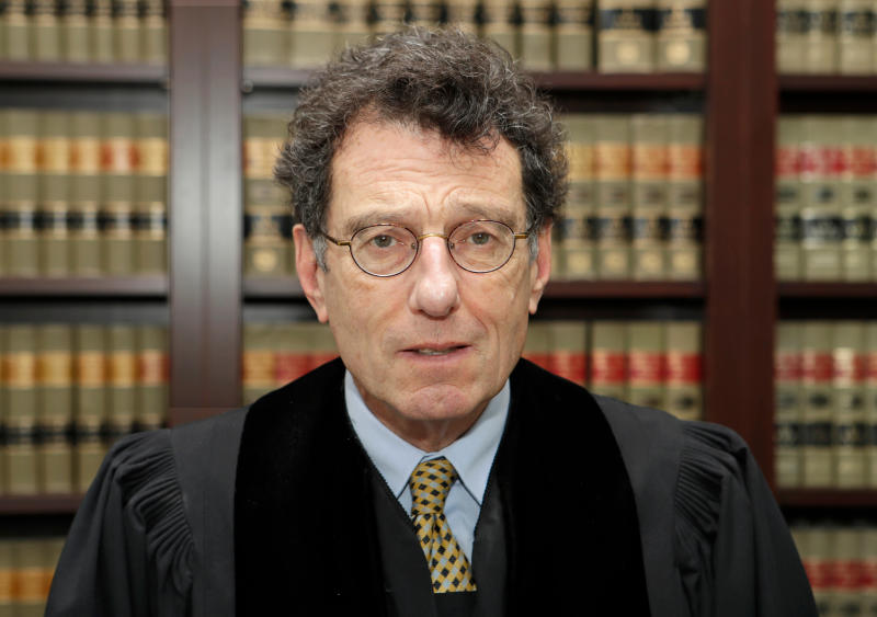 FILE – In this Jan. 11, 2018, file photo, U.S. District Judge Dan Polster poses for a portrait in his office in Cleveland. Polster He has ruled that lawsuits filed by the Ohio counties of Cuyahoga, which includes Cleveland, and Summit County, which includes Akron, will be heard first in October 2019. (AP Photo/Tony Dejak, File)