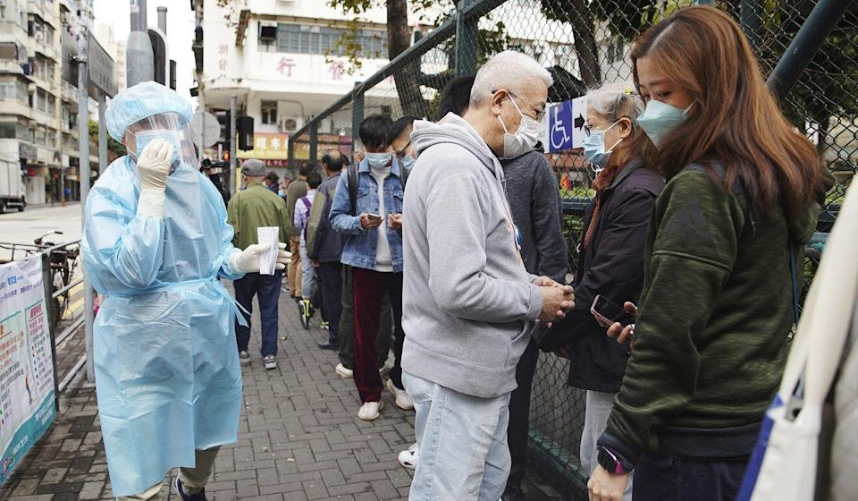 People queue up for Covid-19 screening at mobile testing point at Maple Street Playground in Sham Shui Po on Wednesday. Photo: Winson Wong
