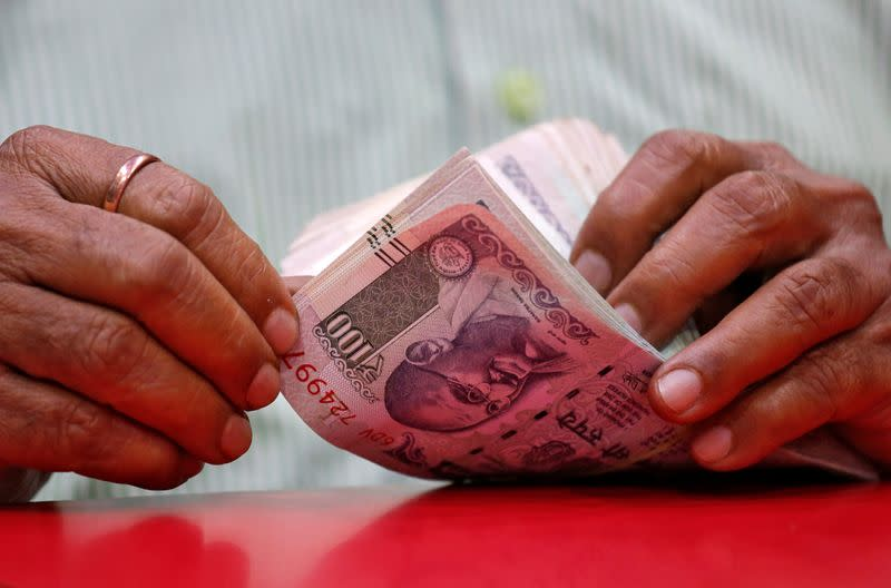Rupee posts biggest weekly gain in 20 months as RBI stands aside