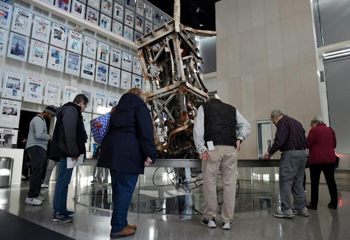Visitors to the Newseum view a section of the television antenna that once sat atop the World Trade Center's north tower, part of the exhibit on the media and the attacks of September 11, 2001 (AFP Photo/Olivier Douliery)