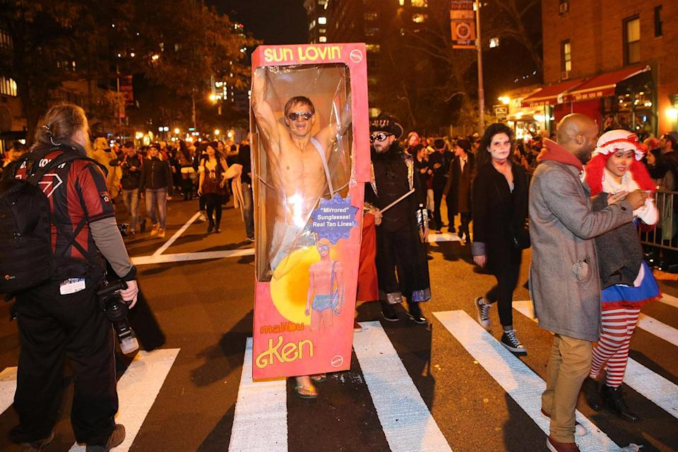 <p>A man dressed as a Ken doll walks in a box in the 44th annual Village Halloween Parade in New York City on Oct. 31, 2017. (Photo: Gordon Donovan/Yahoo News) </p>