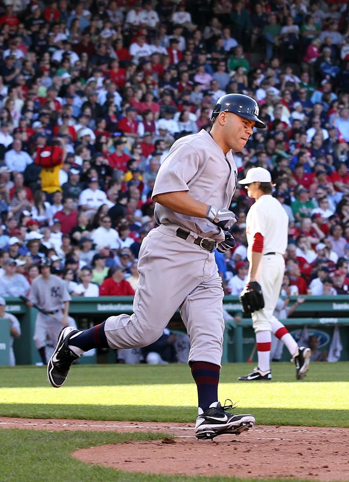 BOSTON, MA - APRIL 20:  Russell Martin #55 of the New York Yankees rounds first base after he hit a home run against Clay Buchholz #11 of the Boston Red Sox at Fenway Park April 20, 2012 in Boston, Massachusetts. (Photo by Jim Rogash/Getty Images)