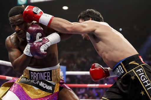 Manny Pacquiao, right, throws a left to Adrien Broner during the WBA welterweight title boxing match Saturday, Jan. 19, 2019, in Las Vegas. (AP Photo/John Locher)