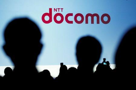 People attend a product unveiling event of the Japanese mobile communications company NTT Docomo in Tokyo