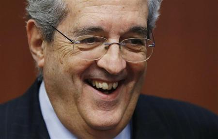 Italy's Economy Minister Saccomanni smiles at the start of an euro zone finance ministers meeting in Brussels