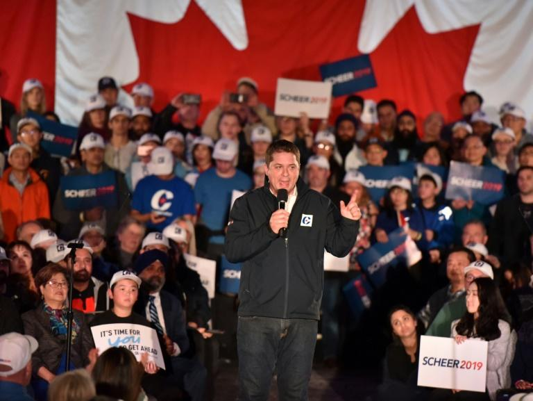 Conservative Party leader Andrew Scheer, speaking at a rally in Richmond, British Columbia, has struggled to win over Canadians partly because of his bland minivan-driving dad persona (AFP Photo/Don MacKinnon)