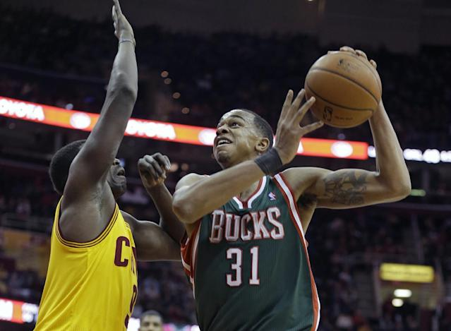 Milwaukee Bucks' John Henson (31) shoots against Cleveland Cavaliers' Luol Deng in the first quarter of an NBA basketball game, Friday, Jan. 24, 2014, in Cleveland. (AP Photo/Mark Duncan)