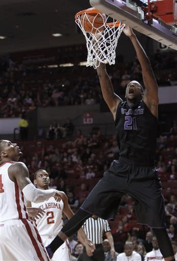 Kansas State forward Jordan Henriquez (21) goes up for a dunk as Oklahoma's Romero Osby and Steven Pledger (2) watch during the first half of an NCAA college basketball game in Norman, Okla., Saturday, Feb. 2, 2013. (AP Photo/Alonzo Adams)