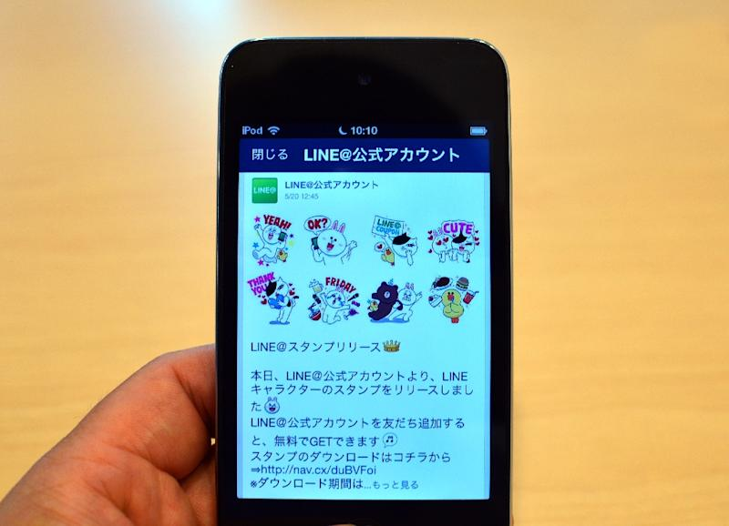 Messaging app Line said June 10 it will list its shares in Tokyo and New York, in a sale valuing the firm at about $5.5 billion, as it looks to spread beyond a strong base among smartphone users in Asia (AFP Photo/Yoshikazu Tsuno )