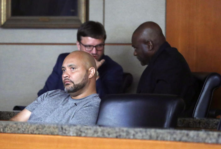 FILE - In this Aug. 23, 2019 file photo, former Houston police officers Steven Bryant, foreground, and Gerald Goines, background, turn themselves in at the Civil Courthouse, in Houston. Bryant, pleaded guilty Tuesday, June 1, 2021, to federal charges in the deaths of two homeowners killed in a 2019 drug raid, admitting he lied and obstructed the resulting investigation. (Karen Warren/Houston Chronicle via AP, File)
