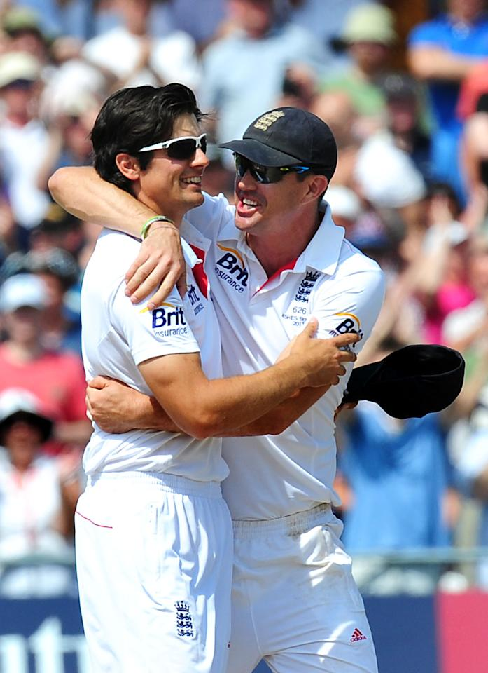 England's Alastair Cook and Kevin Pietersen celebrate after England beat Australia on day five of the First Investec Ashes Test match at Trent Bridge, Nottingham.