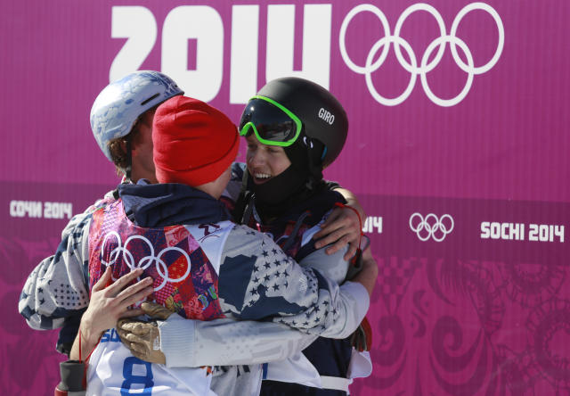 Nicholas Goepper, left, and Gus Kenworthy, center, of the United States congratulate their teammate Joss Christensen, right, after his gold medal win in the men's ski slopestyle final at the Rosa Khutor Extreme Park, at the 2014 Winter Olympics, Thursday, Feb. 13, 2014, in Krasnaya Polyana, Russia. (AP Photo/Gero Breloer)