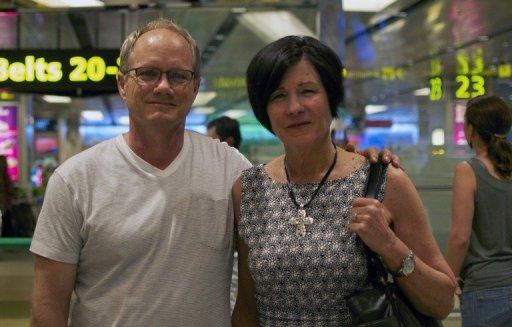Rick (L) and Mary Todd (R), the parents of an US scientist Shane Todd arrive in Singapore on May 6, 2013