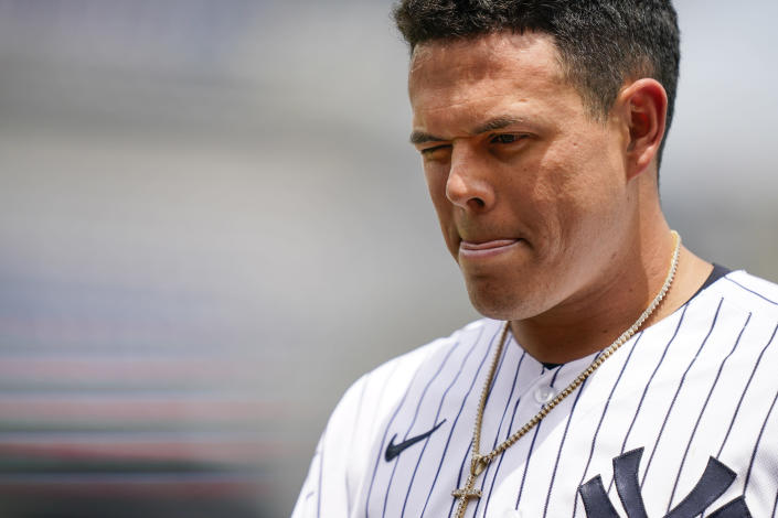 New York Yankees' Gio Urshela winces as he walks back to the dugout after a shard from his broken bat struck his eye when he grounded into a double play in the second inning of a baseball game against the Oakland Athletics, Saturday, June 19, 2021, in New York. (AP Photo/John Minchillo)