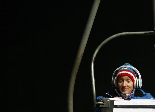 Austria's Daniela Iraschko-Stolz uses a chair lift to go to the ski jump during the women's ski jumping individual normal hill event of the Sochi 2014 Winter Olympic Games, at the RusSki Gorki Ski Jumping Center in Rosa Khutor, February 11, 2014. REUTERS/Michael Dalder (RUSSIA - Tags: OLYMPICS SPORT SKIING)