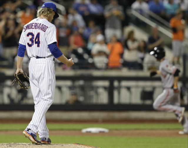 New York Mets starting pitcher Noah Syndergaard stands on the mound as San Francisco Giants' Matt Duffy runs the bases after hitting a home run during the sixth inning of a baseball game Tuesday, June 9, 2015, in New York. (AP Photo/Frank Franklin II)