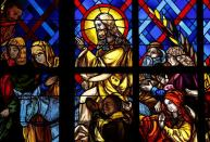 A picture of Ivory Coast former president Felix Houphouet-Boigny who built the basilica is seen in a scene of the entry of Christ into Jerusalem draw on a stained glass, during the celabretion of Christmas at the Basilica Notre Dame in Yamoussoukro