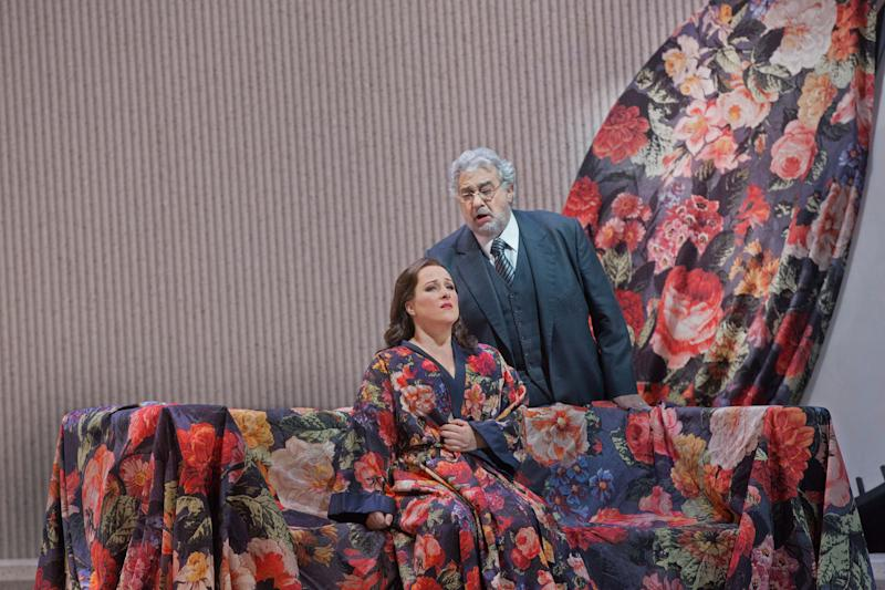 """In this March 11, 2013 photo provided by the Metropolitan Opera Diana Damrau performs as Violetta with Placido Domingo as Giorgio Germont in a scene Verdi's """"La Traviata"""" during a rehearsal at the Metropolitan Opera in New York. (AP Photo/ Metropolitan Opera, Ken Howard)"""