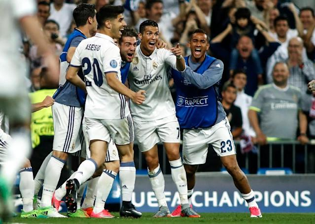 Real Madrid's forward Cristiano Ronaldo (2R) celebrates a goal during the UEFA Champions League quarter-final second leg football match Real Madrid vs FC Bayern Munich at the Santiago Bernabeu stadium in Madrid in Madrid on April 18, 2017 (AFP Photo/OSCAR DEL POZO)
