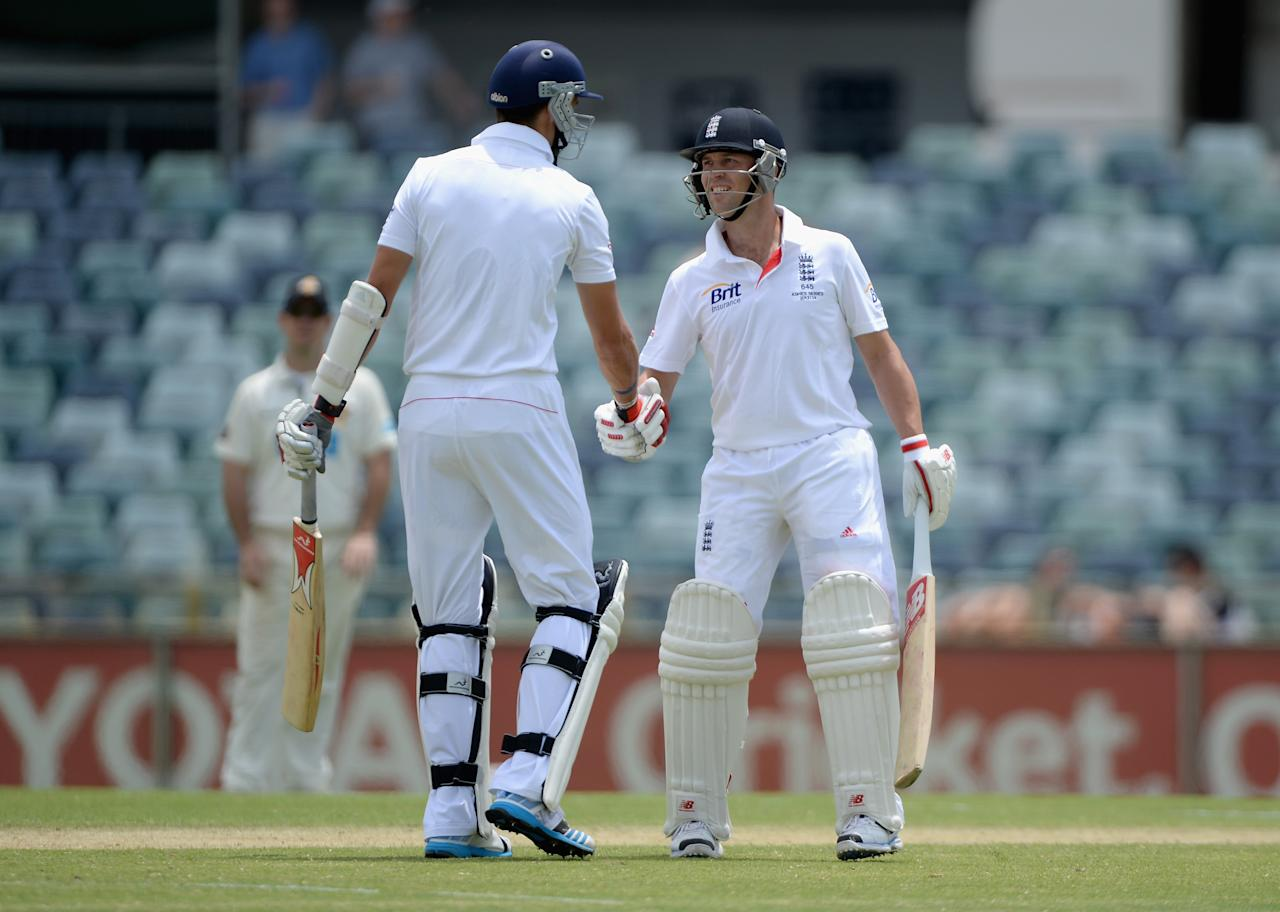 PERTH, AUSTRALIA - NOVEMBER 02:  Jonathan Trott of England shakes hands with Steven Finn after his century during day three of the Tour match between the Western Australia Chairman's XI and England at the WACA on November 2, 2013 in Perth, Australia.  (Photo by Gareth Copley/Getty Images)