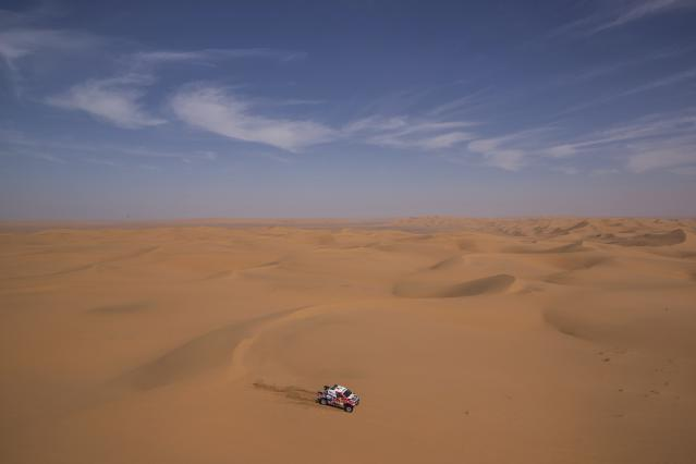 In this Sunday, Jan. 12, 2020 photo, driver Giniel De Villers, of South Africa, and co-driver Alex Haro, of Spain, race their Toyota during stage seven of the Dakar Rally between Riyadh and Wadi Al Dawasir, Saudi Arabia. Formerly known as the Paris-Dakar Rally, the race was created by Thierry Sabine after he got lost in the Libyan desert in 1977. Until 2008, the rallies raced across Africa, but threats in Mauritania led organizers to cancel that year's event and move it to South America. It has now shifted to Saudi Arabia. The race started on Jan. 5 with 560 drivers and co-drivers, some on motorbikes, others in cars or in trucks. Only 41 are taking part in the Original category. (AP Photo/Bernat Armangue)