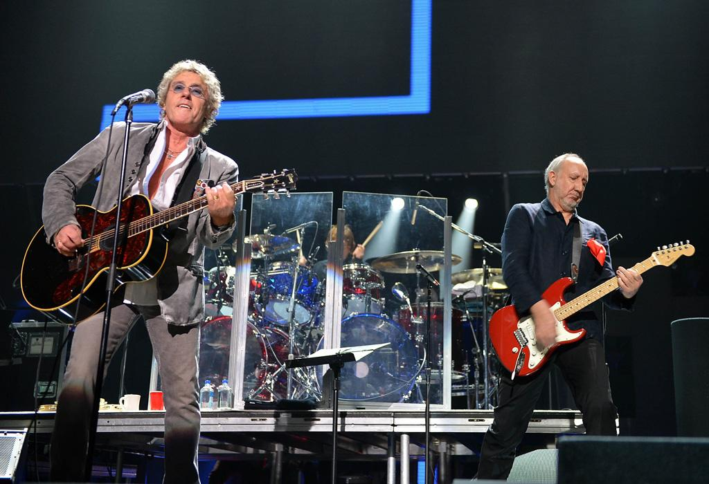 """NEW YORK, NY - DECEMBER 12: Roger Daltrey (L) and Pete Townshend of The Who perform at """"12-12-12"""" a concert benefiting The Robin Hood Relief Fund to aid the victims of Hurricane Sandy presented by Clear Channel Media & Entertainment, The Madison Square Garden Company and The Weinstein Company at Madison Square Garden on December 12, 2012 in New York City. (Photo by Larry Busacca/Getty Images for Clear Channel)"""