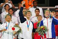 <p>Gold medalist Michael Phelps, silver medalist Takashi Yamamoto of Japan and bronze medalist Stephen Parry of Great Britain celebrate during the medal ceremony of the 200-meter butterfly event on August 17, 2004 during the Athens Olympics. (Nick Laham/Getty Images)</p>