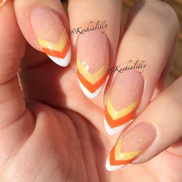 """<p>Go chevron with a nude base and candy corn colors: white, orange, and yellow, of course!</p><p><a class=""""link rapid-noclick-resp"""" href=""""https://www.amazon.com/Adhesive-Creative-Design-Sticker-Strong/dp/B076MWXDHM/ref=sr_1_11_s_it?tag=syn-yahoo-20&ascsubtag=%5Bartid%7C10055.g.1421%5Bsrc%7Cyahoo-us"""" rel=""""nofollow noopener"""" target=""""_blank"""" data-ylk=""""slk:SHOP NAIL ART GUIDE TAPE"""">SHOP NAIL ART GUIDE TAPE</a></p><p><a href=""""https://www.instagram.com/p/sYDalCzPkO/&hidecaption=true"""" rel=""""nofollow noopener"""" target=""""_blank"""" data-ylk=""""slk:See the original post on Instagram"""" class=""""link rapid-noclick-resp"""">See the original post on Instagram</a></p>"""